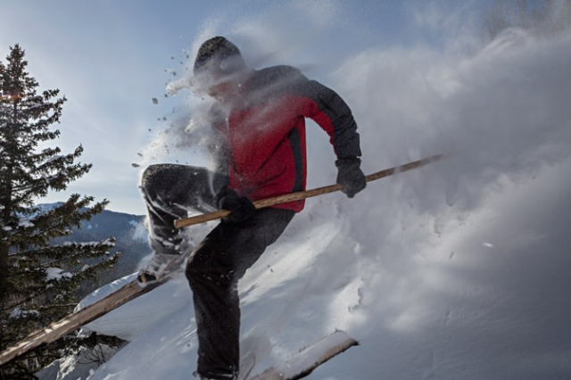 altay skiier-blasting-through-powder