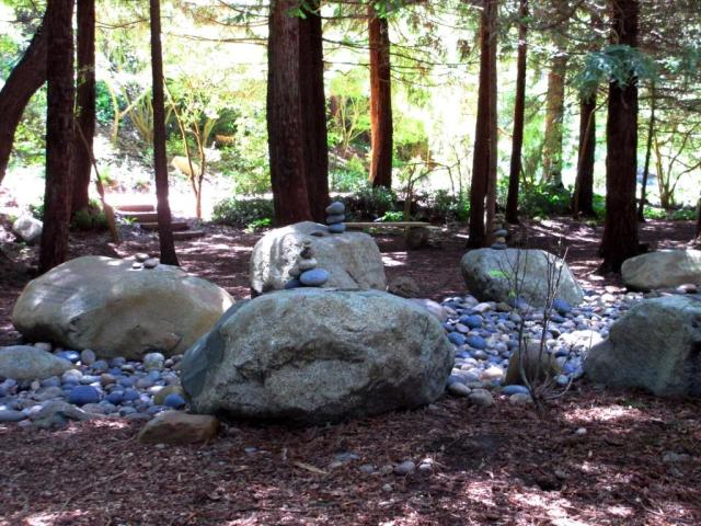 """Several sets of stacked stones ringed the """"river."""""""