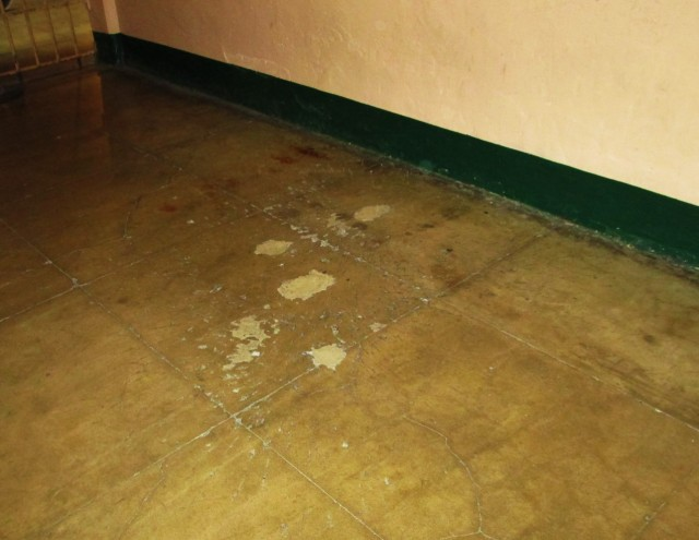These pockmarks in the concrete floor were left by the exploding grenades.