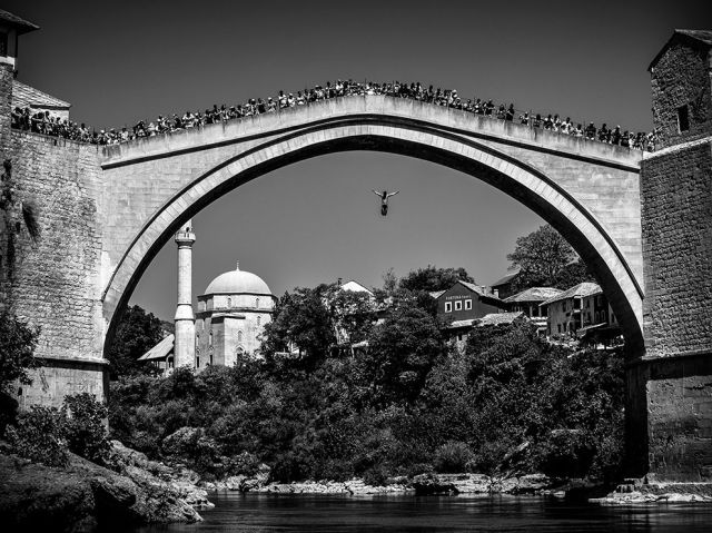 bridge jumping-stari most aka old bridge-mostar-bosnia and herzegovina_chester boyes